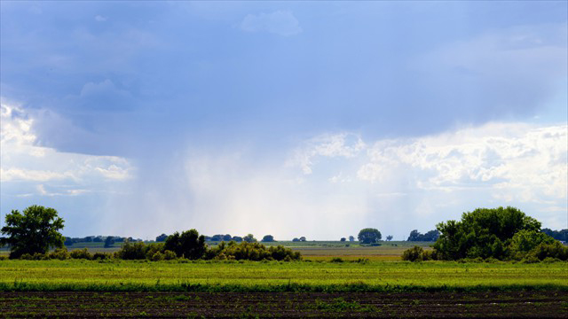 Rich farm fields and summer showers just west of town
